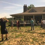 Friends and family watching the eclipse in our backyard in August. We've rehabbed our grass since then, so it no longer looks like Arizona.